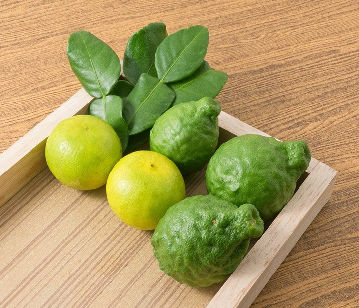 some Persian Limes inside a wooden box