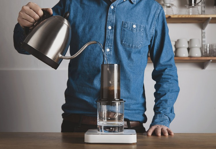 pour-water-into-Keurig-Coffee-Machine