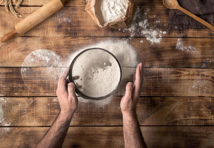 Shake the flour out of the sifter