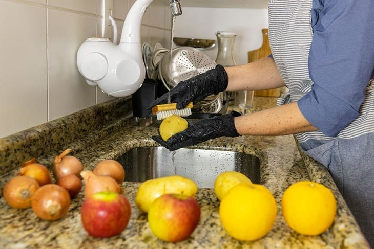Use a scrubbing brush/ exfoliating bath gloves to take off the dirt and the pesticides